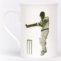 Unique British made Georgie Parker green Sticky Wicket bone china mug.